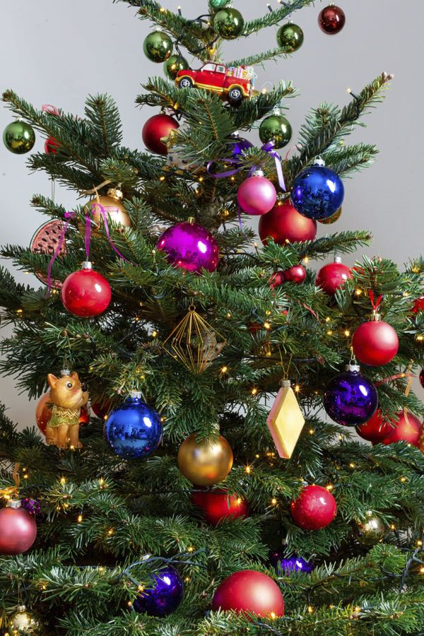 Decorated Christmas tree with different colors. (Size S)